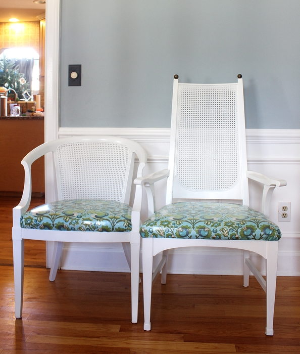 cane chairs made over with white paint and squirrel fabric