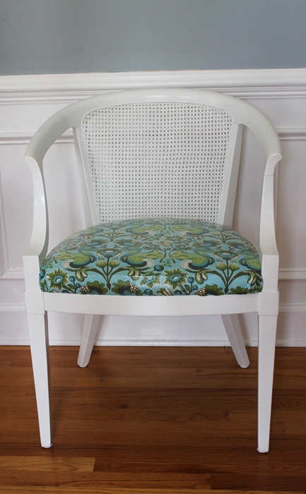 cane chair makeover with white paint and squirrel print fabric