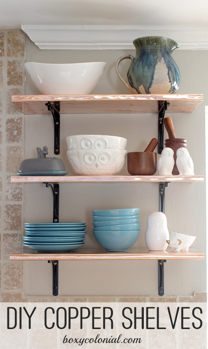 Open shelving in kitchen made with copper sheeting