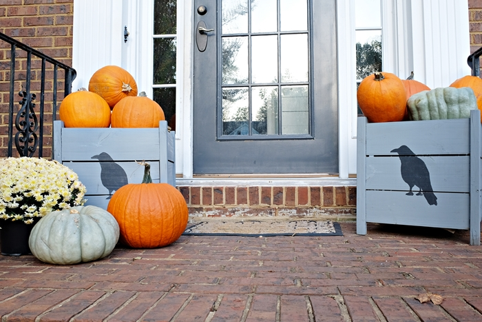 front porch with pumpkins and mums and raven planters