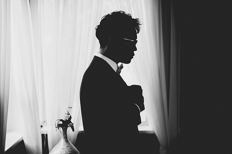 groom in shadow