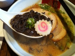 """Kuro-obi"" No. 2 - Black squid ink ramen noodles in original 'tonkotsu' (pork) shoyu soup. Topped with chashu pork, menma, cabbage, naruto, and scallions."