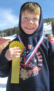 Our younger son, showing off his hardware (3rd and 5th) after the Colorado Buddy Werner League State Race at Beaver Creek in 2006.