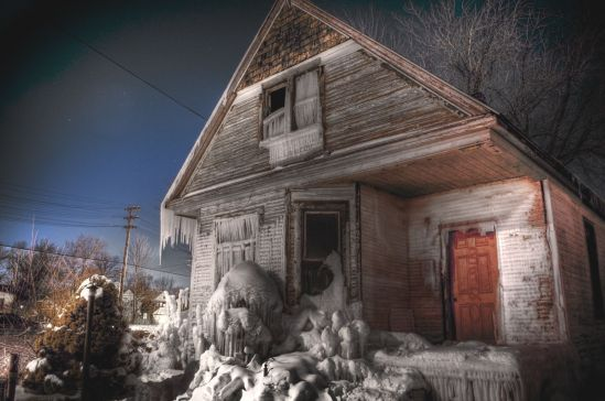 A project where artists covered a house in ice to raise awareness about vacant homes. PHOTO CREDIT: John Cruz, misplacedfocus.com