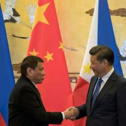 Philippine President Rodrigo Duterte and Chinese President Xi Jinping shake hands after a signing ceremony held in Beijing