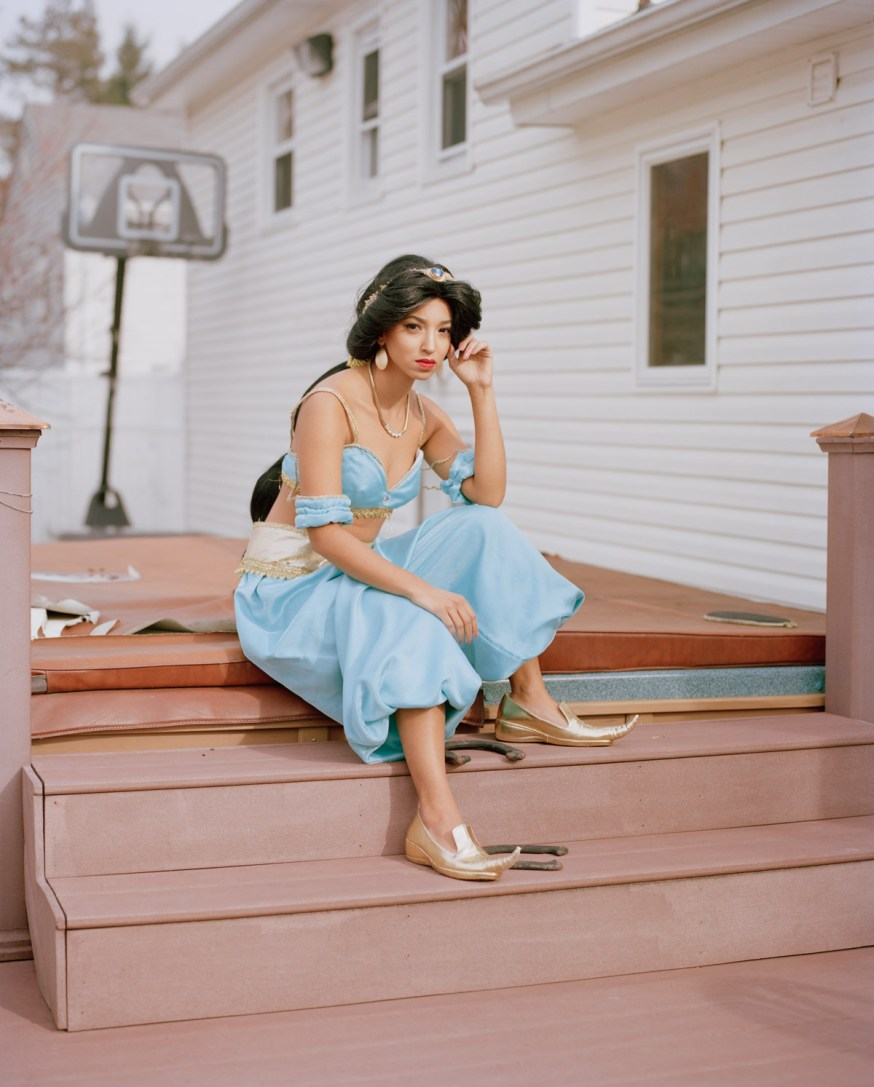 Refinery29 Feature Real Life Disney Princesses Portrait Ordinary Woman Works Impersonates Disney Princess Jasmine sitting on steps to Jacuzzi Hot Tub New Jersey