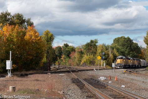New England Central southward freight waits to cross CSXT's former Boston & Albany at Palmer, Massachusetts on October 14, 2015.