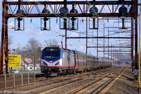 I always like to catch the long-distance trains under wire. Amtrak ACS-64 606 leads train 91 the Silver Star on its run to Miami, Florida. Photographing the German-designed electrics under old PRR signal bridges makes for a contrast in time and technology that helps tell the story of today's Northeast Corridor.