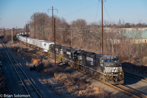 Not all important railroads are blessed with pastoral scenery. The catenary poles and wires tell of the Trenton Cutoff's history. At one time Pennsylvania Railroad's P5A, GG1 and E44 electrics plied the line. More has changed than the just locomotives