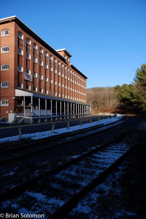 Sometimes the shadows conspire against making the desired view of the train. By the time Mass-Central arrived at Thorndike, the shadows had covered the tracks. Oh well, a challenge for another day.