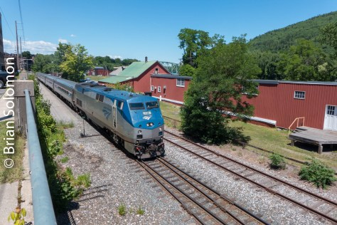 On June 18, 2016, Amtrak P42 number 106 leads train 57, the southward Vermonter. This view is from a parking lot immediately south of the passenger platform in Brattleboro. Exposed with my Lumix LX7.