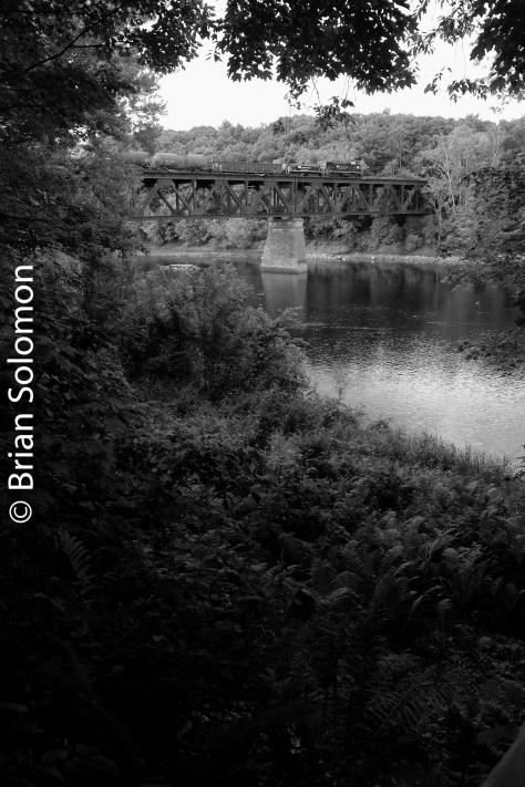 Number 2. This digital image was made using my FujiFilm X-T1 in a monochrome mode. I altered the output through the addition of a digital 'red' filter, that slightly darkened the blue areas of the image including the locomotive on the bridge.
