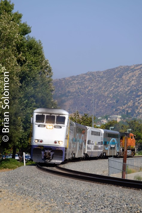 Metrolink's scheduled train 115 accelerates away from its Simi Valley station stop in July 2016.