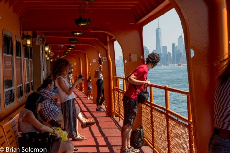 Passengers make photos and take in the see-air.