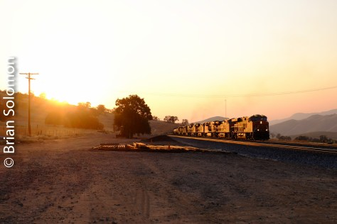 Here I've included the setting sun. This shows the angle of the light relative to the train necessary to produce the glint effect. I'm standing at the Bealeville grade crossing.