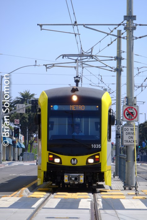 A telephoto view exposed with my FujiFilm X-T1 of a modern light rail car approaching Santa Monica.