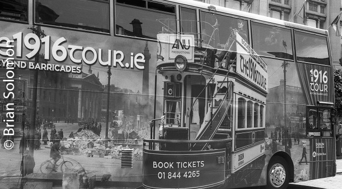 Real Photo of Photo Collage of Trams on the side of a Bus—Dublin, September 2016.