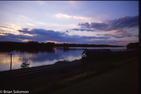 An Amtrak Empire Service train led by a dual-mode GE Genesis diesel makes for a modern silhouette along the Hudson at Castleton, New York in 2004. Exposed on Fujichrome using a Contax G2 rangefinder with 28mm Zeiss Biogon.