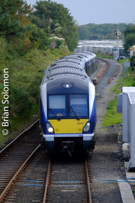 A Derry-bound NIR railcar approaches Castlerock as viewed from the footbridge.