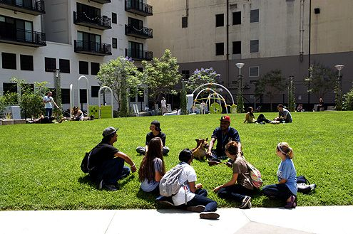 Shortly after the park opened, it already became a community gathering spot with many sitting on the lawn