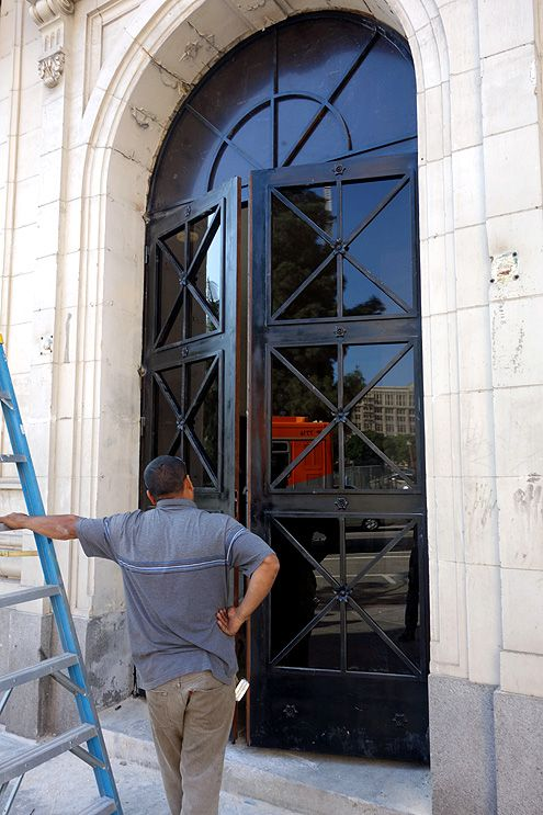 After plywood removal, workers have been seen doing construction on the exterior metal doors