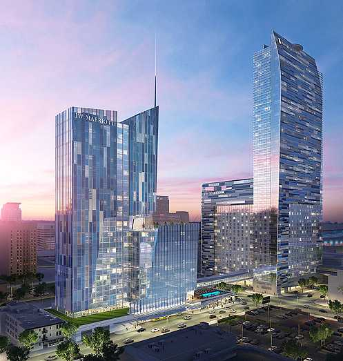 A new rendering of the proposed JW Marriott expansion shows a gleaming 38-story tower (left) with 755 rooms totaling 1,756 rooms (Photo: AEG)