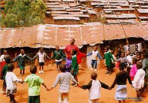 Children and teacher playing.