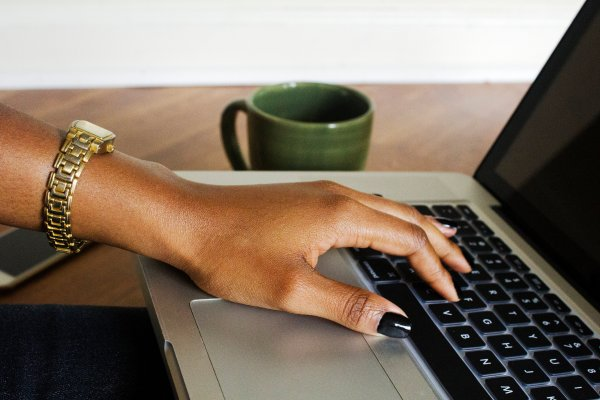 black-woman-hand-on-laptop-createherstock