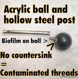 Hollow steel barbell with acrylic balls