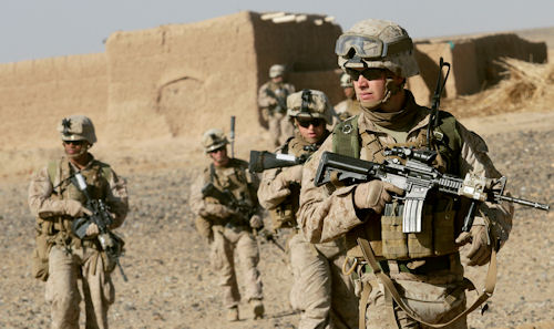 U.S. Marine Sgt. Bryan Early, a squad leader with 1st Battalion, 9th Marine Regiment, leads his squad of Marines to the next compound while patrolling in Helmand province, Afghanistan, Dec. 19. Early is responsible for planning the squad's patrols, the safety of his Marines, and achieving his commander's intent, before, during, and after an operation. (U.S. Marine Corps photo by Cpl. Austin Long)
