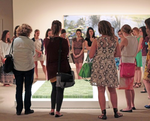 Attendees explore exhibition artworks, including Organic Matters artist Dawn Holder's Monoculture; Photo credit: Laura Hoffman