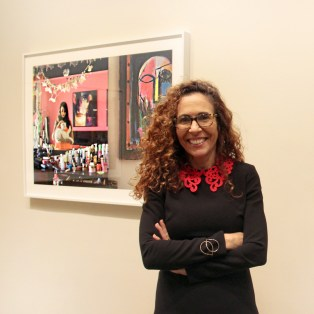 Rania Matar at NMWA in front of one of her photographs in She Who Tells a Story; Photo: NMWA