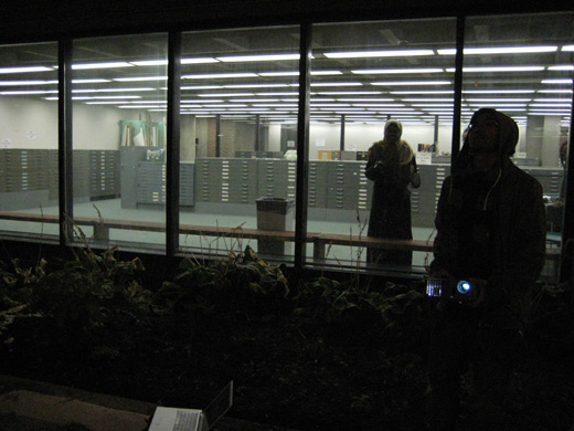 Audience in the library as Broken City Lab tests projection sites throughout the University