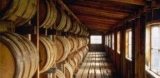 Bourbon barrels in a rick house. (rotterdamblues / Flickr)