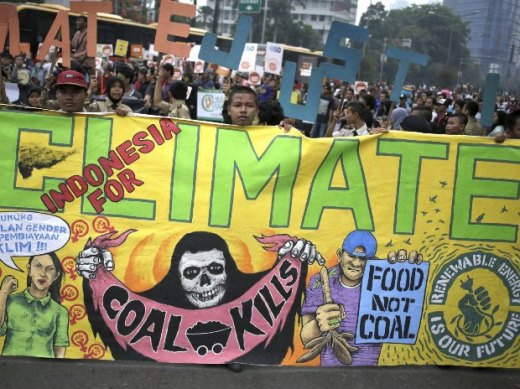 Activists display banners during the Global Climate March in Jakarta