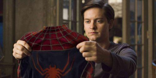 Peter-parker-holding-spider-man-suit