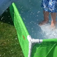 splashing in paddling pool
