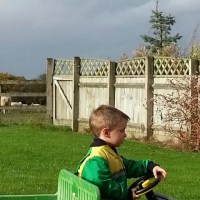 john deere overalls and gator riding in the garden