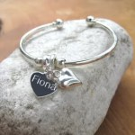 Win a personalised puff heart bangle with Prezzybox.