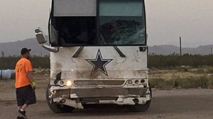Cowboys tour bus involved in crash that kills four.