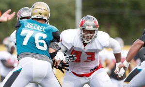 Gerald McCoy limps off practice field