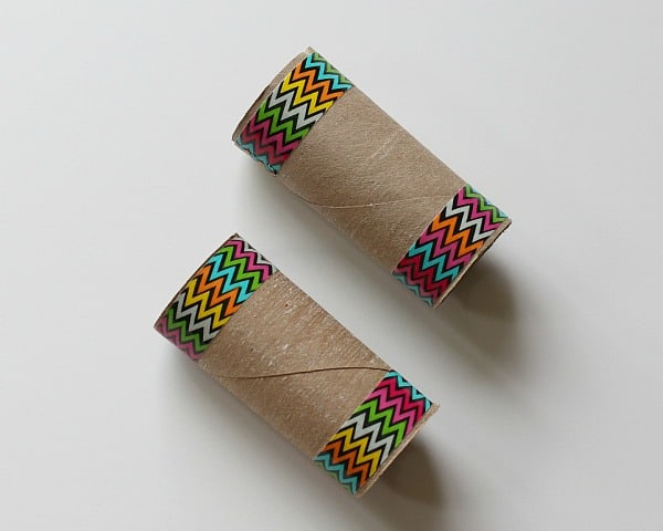 add colorful tape to toilet paper rolls to make binoculars