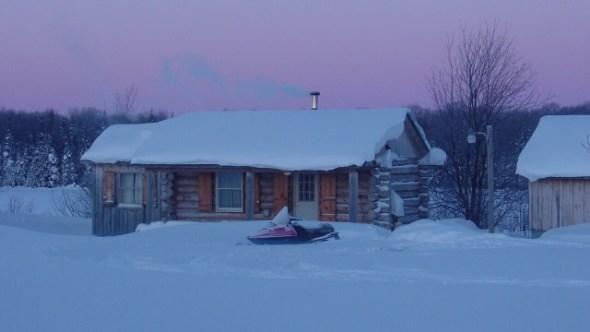Tiny log cabin in winter, upstate New York