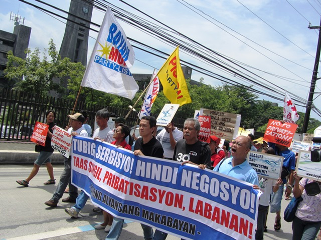 Members of Bayan, KMU, Piston, All-UP Workers Union, UP-Balara community residents march Jul 5 to the gates of main offices of Maynilad, Manila Water and MWSS (Photo by M. Salamat / bulatlat.com)