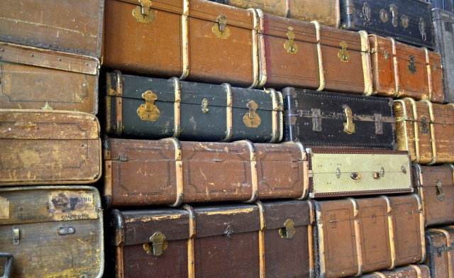 Antique luggage and trunks stacked high