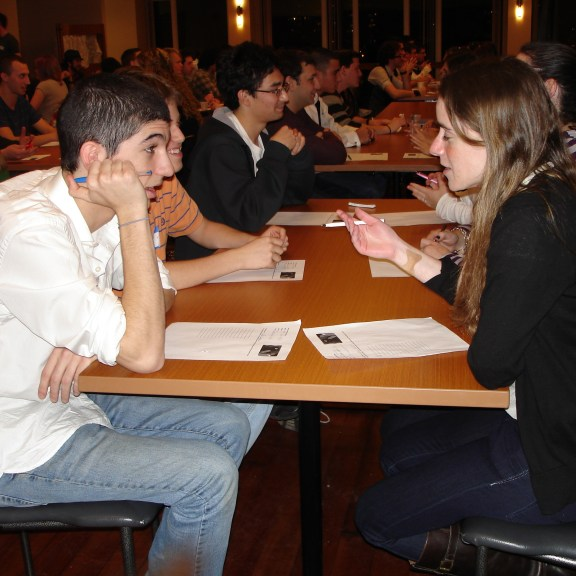 Daters search for matches during their two minute chats at Hillel's Speed Dating | Photo by Rachel Stine