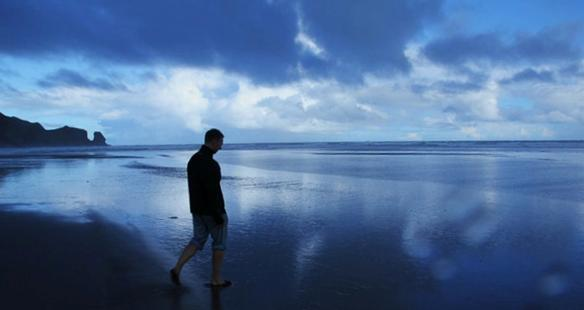 Jonah Lundberg walking on Bethells Beach in Auckland, New Zealand. | Photo by J. Patrick Lisazo, University of Texas - San Antonio