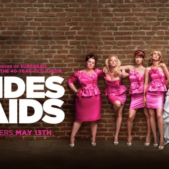 The usual suspect: ugly cocktail dresses. Bridesmaids Poster.