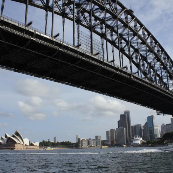 The Sydney Opera House and imposing Harbour Bridge. Photo by Noah Eberhart.