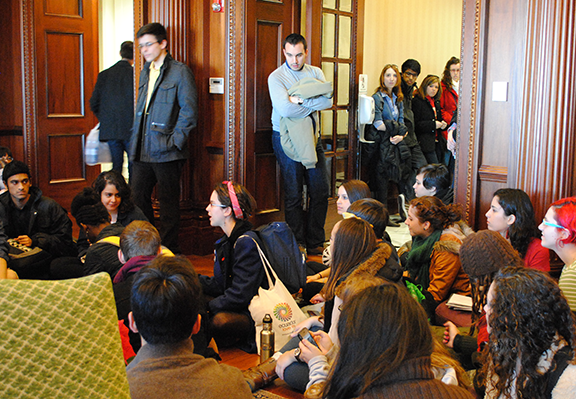 Students sat on the floor of President Brown's foyer for about 45 minutes before being escorted out of the building by BUPD. | Photo by Carol Chin